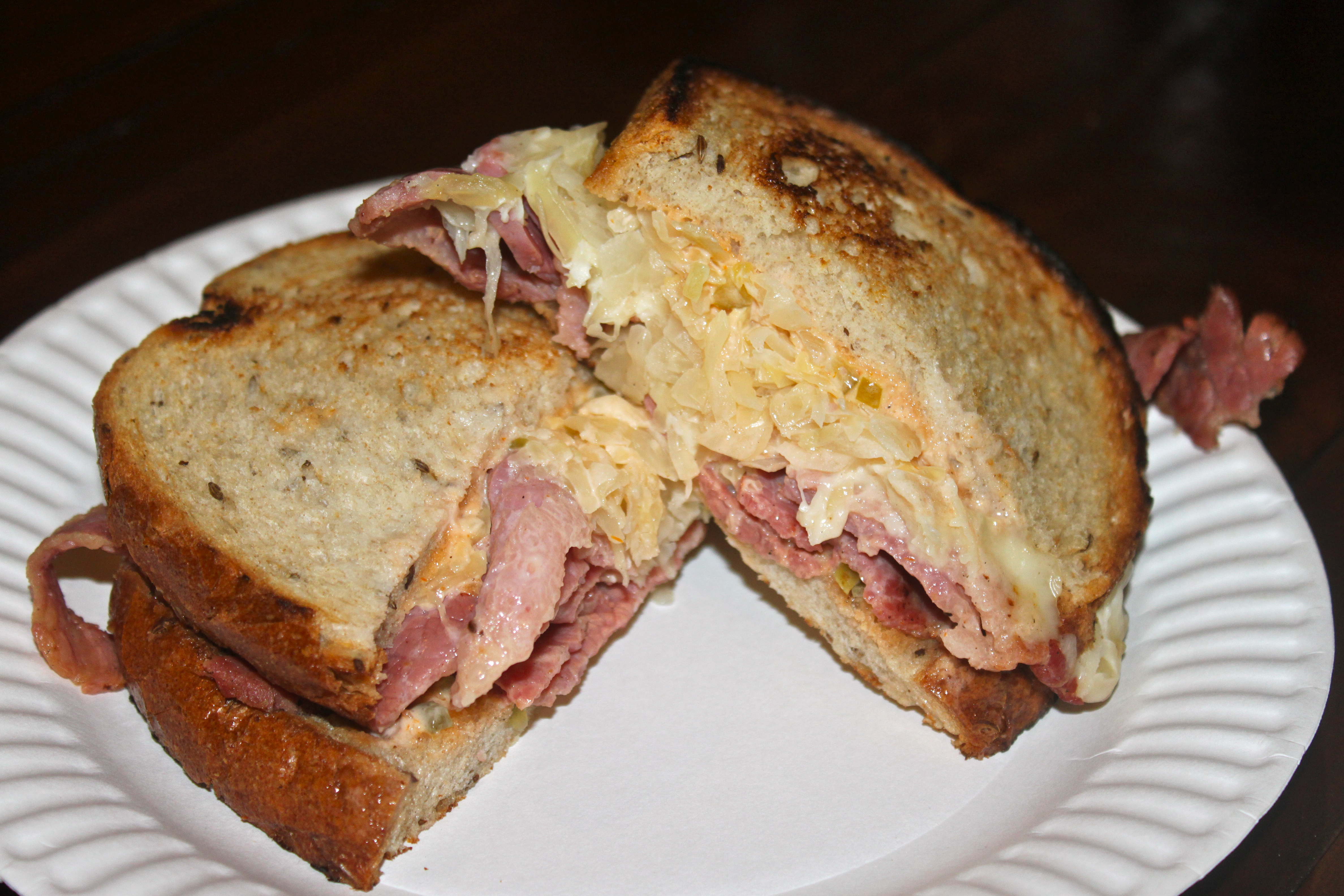 ... hot corned beef, griddled sauerkraut, swiss and russian on rye bread