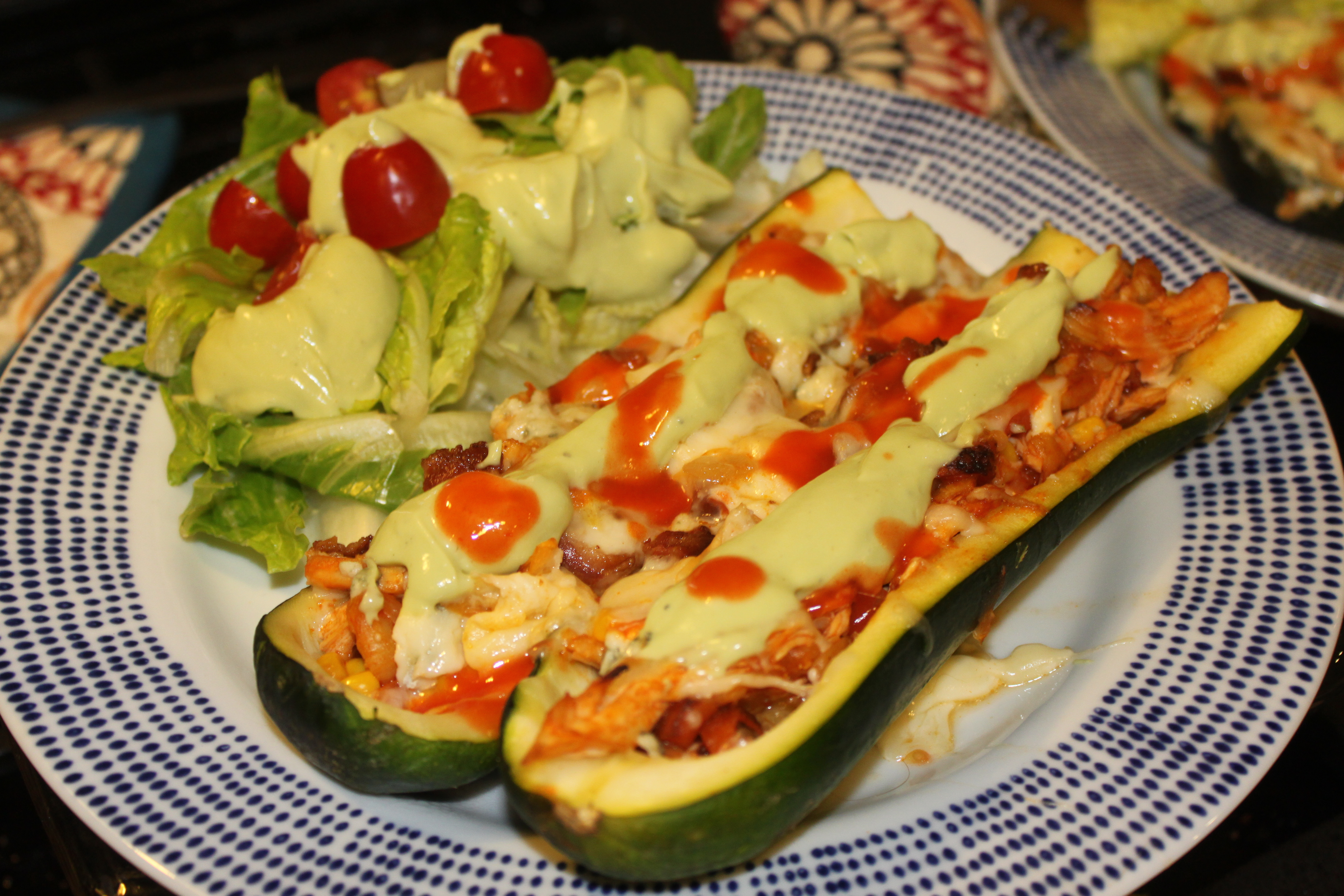 ... topped with Melted Cheese, Bacon and an Avocado Blue Cheese Dressing