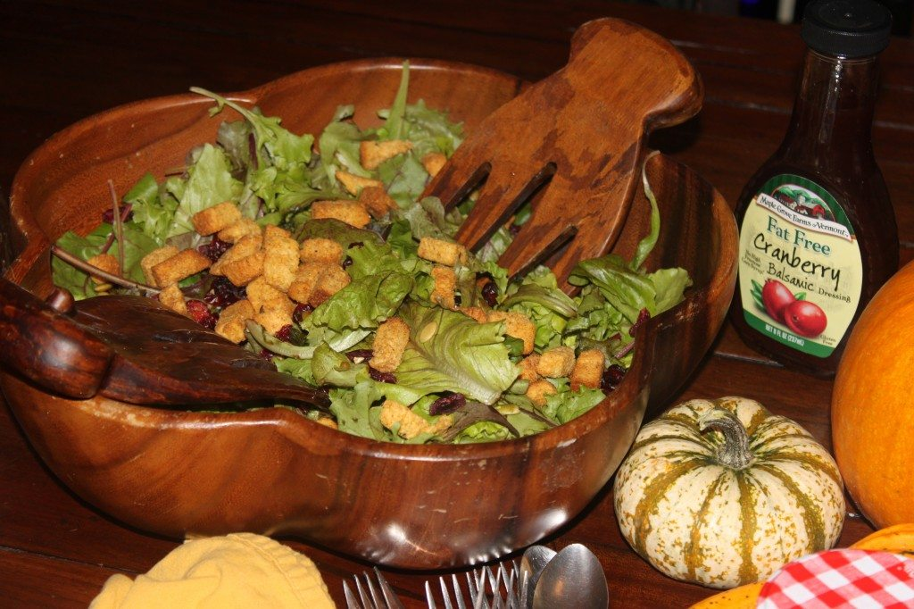 A Fall salad with pumpkin cornbread croutons, craisins, pumpkin seeds and cranberry vinaigrette.  Not from a cookbook, just to lighten things up.