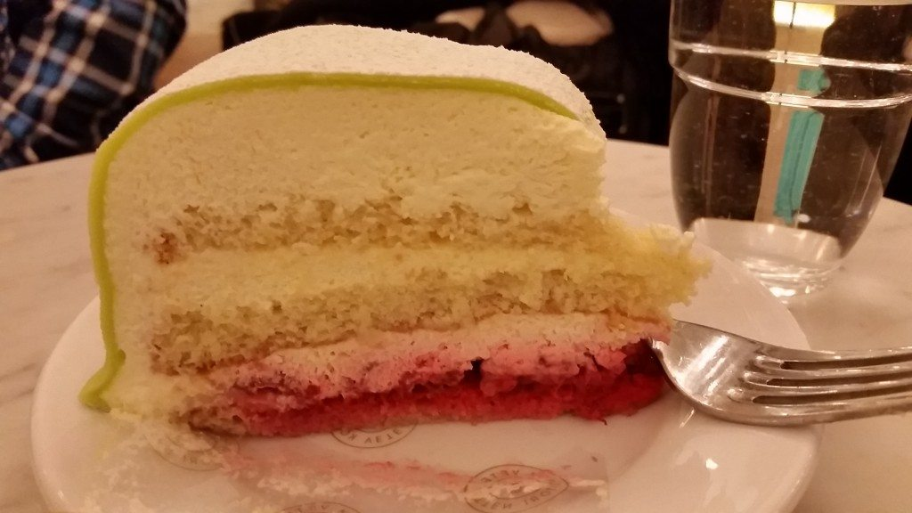 Inside of the princess cake, a layer cake with strawberries and cream, topped with marzipan fondant.