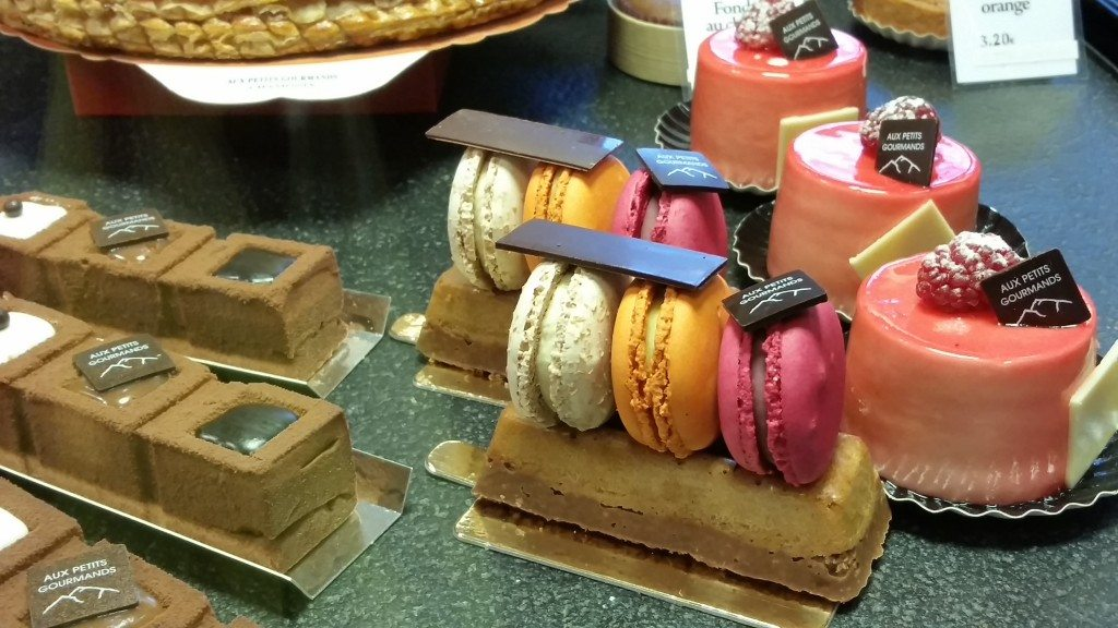 Because why have a macaron when you can have three macarons on top of a pastry?