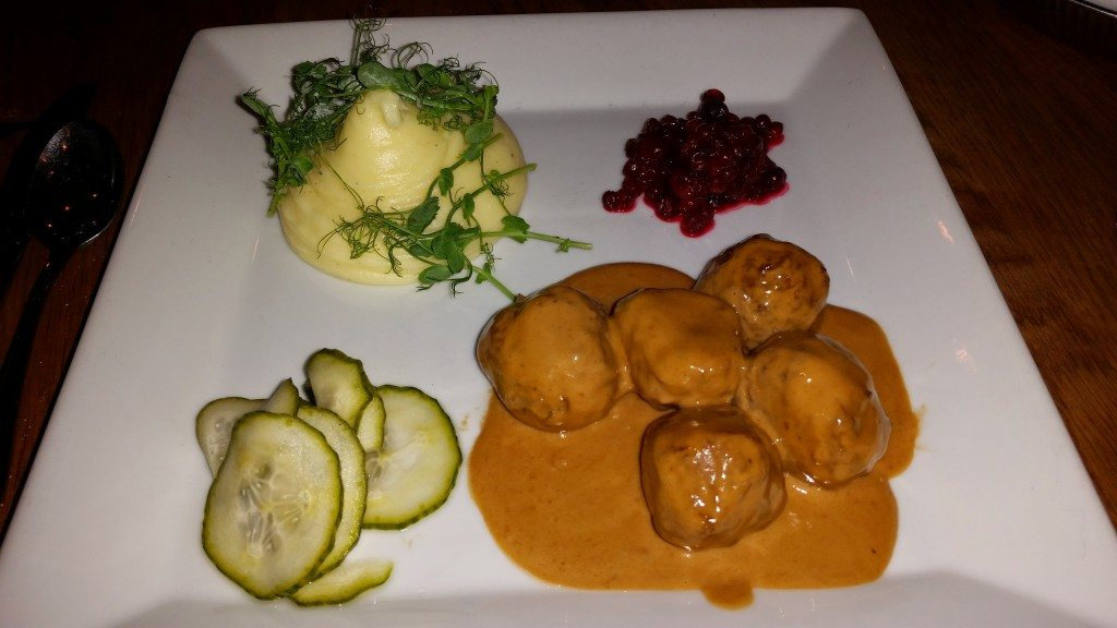 Swedish meatballs with mashed potatoes, pickled cucumbers and ligonberry jam.