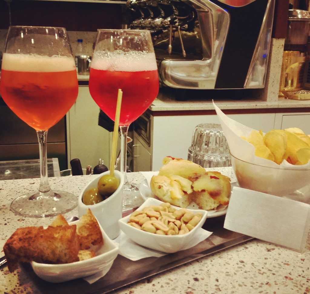 A traditional apertivo spread with comapri and aperol spritz at a Venetian bar where Vickie and I very quickly would have become locals.