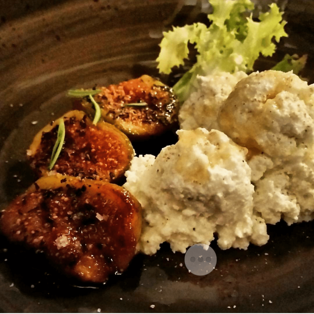 Housemade ricotta with figs, drizzled with honey at Ratana.